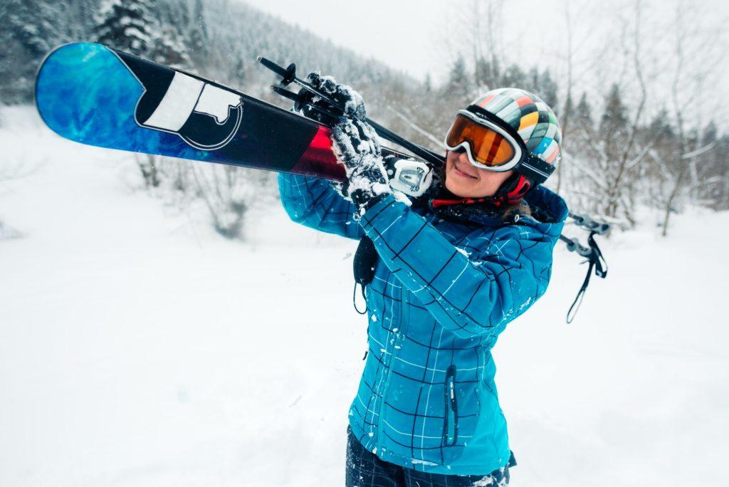 girl go with ski equpment in ski touring